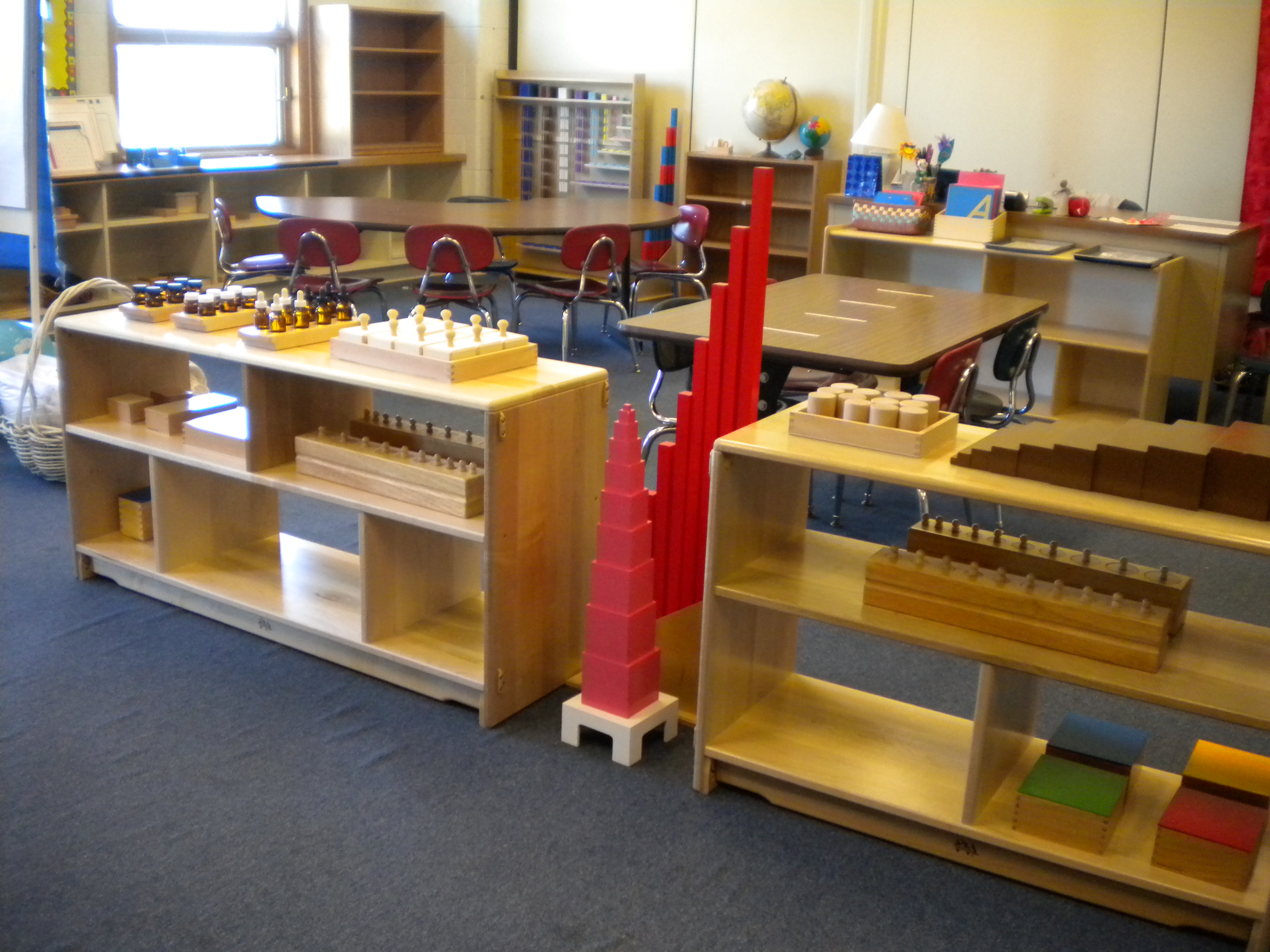 the sensorial area As you glance over to the sensorial area, children will be found working with the  sensorial apparatus – often building a tower with blocks known in the classroom .
